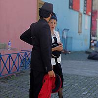 South America, Argentina, Buenos Aires. Tango performers of La Boca neighborhood.