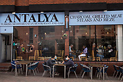 Local residents and visitors enjoy subsidised Bank Holiday Monday lunches at a Turkish restaurant on the final day of the government's Eat Out To Help Out meal scheme on 31 August 2020 in Windsor, United Kingdom. Many restaurant owners have called for an extension to the scheme introduced by the Chancellor of the Exchequer to help preserve hospitality jobs during the COVID-19 pandemic.