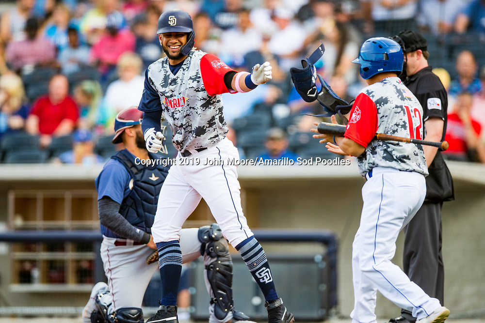 Amarillo Sod Poodles infielder Fernando Tatis Jr. (23)  hands off his gear after being walked against the Frisco Rough Riders on Monday, June 3, 2019, at HODGETOWN in Amarillo, Texas. [Photo by John Moore/Amarillo Sod Poodles]