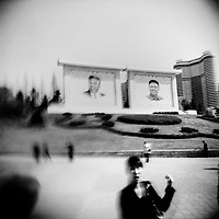 Large portraits of Kim il-Sung and Kim Jong-il preside over Pyongyang, the capital of North Korea.