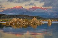 Alpenglow on mountains at sunrise over tufa on the South Shore of Mono Lake, Mono County, Eastern Sierra, California