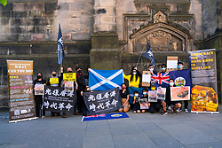 Edinburgh, Scotland, UK. 1 July  2021. On the 1 July which is the 100th anniversary of the founding of the Chinese Communist Party, Hong Kong pro democracy protesters held a rally at St Giles Cathedral on the Royal Mile in Edinburgh. Guest speaker Christine Jardine MSP liberal democrat, voiced her support and urged the UK Government to offer UK visas for all Hong Kong people. Iain Masterton/Alamy Live News