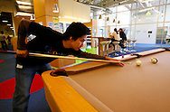Andy Wu, a Google engineer, plays pool with fellow engineers at the Googleplex campus in Mountain View, Calif. on May 15, 2007. (Photo by Jakub Mosur/For Boston Globe)
