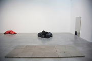 Contemporary art by Gavin Turk in his Who What When Where How & Why, retrospective show at the Newport Street Gallery in London, England, United Kingdom. Pavement. 2008. Bronze work. Nomad, Pile and Pistoletto's Pile, bronze works.  (photo by Mike Kemp/In Pictures via Getty Images)