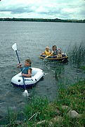 Cousins out on boating expedition ages 4 and 8.  Clitherall Minnesota USA
