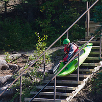 Peter Thompson launches his kayak down stairs into the Kananaskis River in the Canadian Rockies near Calgary, Alberta.