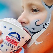 John Schwartz Jr., of Beaufort, enjoys a snow cone after having his face  Saturday during the 59th Annual Beaufort Water Festival on July 19, 2014.