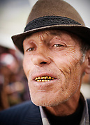 Portrait of a man with golden teeth in the Khorog bazaar.<br /> The town of Khorog (2200m), is the capital of the Gorno-Badakhshan Autonomous Province (GBAO) in Tajikistan. It is situated in the Pamir Mountains (ancient Mount Imeon) at the confluence of the Gunt and Panj rivers.<br /> The city is bounded to the south and to the north by the deltas of the Shakhdara and Gunt rivers, respectively. The two rivers merge in the eastern part of the city flow through the city, dividing it almost evenly until its delta in the river Panj, also being known as Amu Darya, or in antiquity the Oxus on the border with Afghanistan. Khorog is known for its beautiful poplar trees that dominate the flora of the city.<br /> Khorog is one of the poorest areas of Tajikistan, with the charitable organization Aga Khan Foundation providing almost the only source of cash income. Most of its inhabitants are Ismaili Muslims.<br /> <br /> Tajikistan, a mountainous landlocked country in Central Asia. Afghanistan borders it to the south, Uzbekistan to the west, Kyrgyzstan to the north, and People's Republic of China to the east. Tajikistan also lies adjacent to Pakistan separated by the narrow Wakhan Corridor.<br /> Tajikistan became a republic of the Soviet Union in the 20th century, known as the Tajik Soviet Socialist Republic.<br /> It was the first of the Central Asian republic to gain independence in December 1991.