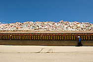 The Gyanak Mani Temple is the largest collection of carved prayer stones (mani stones) in Tibet. There are several billion prayer stones stacked 3 meters (10 feet) high in a 1 square kilometer area.