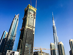 Pic of skyscrapers, with the Burj Khalifa, the world's tallest building, in Dubai. Images from the MSC Musica cruise to the Persian Gulf, visiting Abu Dhabi, Khor al Fakkan, Khasab, Muscat, and Dubai, traveling from 13/12/2015 to 20/12/2015.
