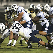 ORLANDO, FL - OCTOBER 09:  Paul Lasike #33 of the Brigham Young Cougars loses his helmet as he is brought down by Tyler Linde #53 of the UCF Knights at Bright House Networks Stadium on October 9, 2014 in Orlando, Florida. (Photo by Alex Menendez/Getty Images) *** Local Caption *** Paul Lasike; Tyler Linde