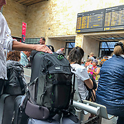 Commuters wait for their trains at the train station in Florence, Italy.