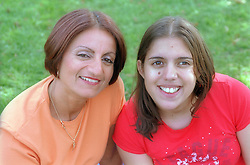 Portrait of mother and daughter; smiling,