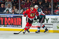 KELOWNA, BC - MARCH 03:  Robbie Fromm-Delorme #11 of the Portland Winterhawks checks Ted Brennan #10 of the Kelowna Rockets at Prospera Place on March 3, 2019 in Kelowna, Canada. (Photo by Marissa Baecker/Getty Images)