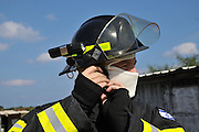 Portrait of a fire fighter in fire resistant clothes