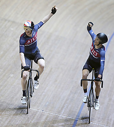 JLT Condor's Ed Clancy (left) and Jon Mould celebrates winning the Men's 6 Lap Dash, during round three of the Revolution Series at the Manchester Velodrome, Manchester.