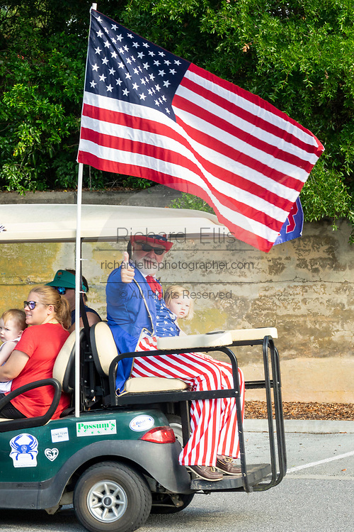 Uncle Sam gives a thumbs up from the back of a decorated golf cart during the annual Independence Day golf cart and bicycle parade July 4, 2019 in Sullivan's Island, South Carolina. The tiny affluent Sea Island beach community across from Charleston holds an outsized golf cart parade featuring more than 75 decorated carts.