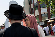 Following the attack on a group of Muslim men outside the Finsbury Park mosque which killed one person and seriously injured another ten, a Muslim lady talks to a Jewish leader, on 19th June 2017, in the borough of Islington, north London, England.