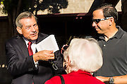 09 NOVEMBER 2013 - PHOENIX, AZ: US Representative DAVID SCHWEIKERT (R-AZ), left, talks to constituents in front of his district office in Scottsdale. Congressman Schweikert represents Arizona's 6th Congressional District. Most of the district is in Scottsdale, a wealthy suburb of Phoenix and one of the wealthiest cities in the United States. Schweikert is a staunch conservative and popular with the Tea Party. He supported the government shutdown in October.     PHOTO BY JACK KURTZ