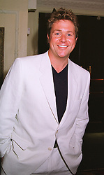 Singer MICHAEL BALL at a luncheon in London on 25th June 1999.MTT 30