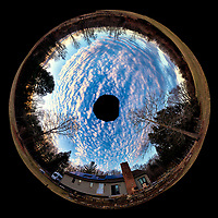Inverse Little Planet Panorama of Late Afternoon Winter Clouds and Sky Over New Jersey. Composite of 12 landscape images taken with a Nikon D810a camera and 14-24 mm f/2.8 zoom lens (ISO 200, 14 mm, f/8, 1/100 sec). Raw images processed with Capture One Pro, Photoshop CC, and AutoGiga Pan Promo.