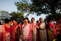 © under license to London News Pictures.  17/10/2010 ©London News Pictures. 17/10/2010. Women watch Devotees carry an idols of Hindu goddess Durga before immersing it in the river Ganges on the last day of the Durga Puja festival on October 17, 2010 in Kolkata, India. The festival is the biggest of the year in the Indian state of Bengal and celebrates the worship of the Hindu Goddess Durga, who in Hindu Mythology is celebrated as the Goddess of power and the victor of good over evil.