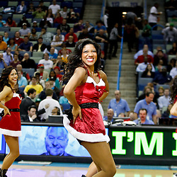 December 21, 2011; New Orleans, LA, USA; New Orleans Hornets Honeybees dancers perform during the second quarter of a game against the Memphis Grizzlies at the New Orleans Arena. The Hornets defeated the Grizzlies 95-80.   Mandatory Credit: Derick E. Hingle-US PRESSWIRE