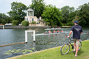"""Henley on Thames, United Kingdom, 23rd June 2018, Saturday,   """"Henley Women's Regatta"""",  view, Coach, sitting, watching, his crew, in their Heat, as they pass the """"Temple Folly"""", on. """"Temple Island"""", Henley Reach, River Thames, Thames Valley,  England, © Peter SPURRIER/Alamy Live News"""