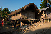 Mising houses<br /> Mising Tribe (Mishing or Miri Tribe)<br /> Majuli Island, Brahmaputra River<br /> Largest river island in India<br /> Assam,  ne India