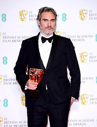 Joaquin Phoenix with his award for Best Actor in the press room at the 73rd British Academy Film Awards held at the Royal Albert Hall, London.