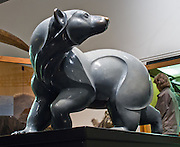 "The Polar Bear ""Arctic Shadow"" statue was cast in bronze with light granite gray patina by Jacques and Mary Regat. Dramatic architecture and distinctive exhibit galleries make the Museum of the North a must-see destination at the University of Alaska, in Fairbanks, Alaska, USA."