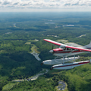 Bush plane in flight over northern Minnesota.