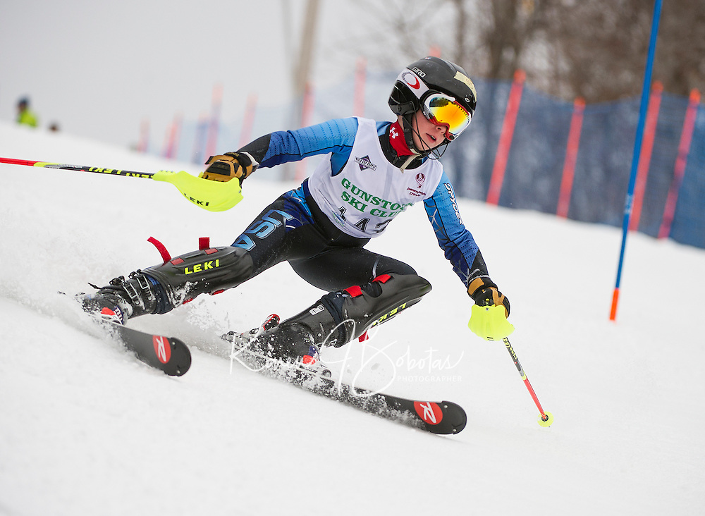 Harry Meehan competes in the U12 boys at the annual Gus Pitou Memorial Slalom with the Gunstock Ski Club on Sunday.  (Karen Bobotas/for the Laconia Daily Sun)