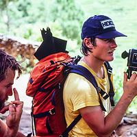 A trekker shoots movie film durong a trek in Nepal, 1980
