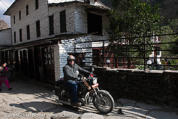 Danny Ochs on the main street of Tatopani starting out on Day-7 of our Himalayan Heroes adventure riding from Tatopani to Pokhara, Nepal. Monday, November 12, 2018. Photography ©2018 Michael Lichter.