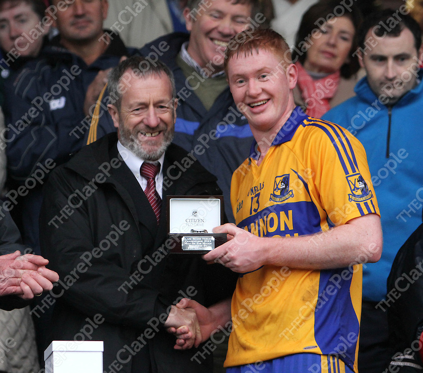 10/11/13   Sixmilebridge's Jamie Shanahan is presented with The Man of the Match Trophy after the Senior Hurling County Final in Cusack Park. Pic Tony Grehan / Press 22
