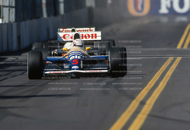 PHOENIX -  MARCH 1991:  Nigel Mansell of Great Britain and the Williams-Renault team approaches a corner during the Formula One United States Grand Prix held in Phoenix, Arizona in March 1991. (Photo by David Madison/Getty Images) *** Local Caption *** Nigel Mansell
