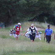 K.J. Choi, South Korea, and Sergio Garcia, (front), Spain, head to the 8th green during the final round of the Travelers Championship at the TPC River Highlands, Cromwell, Connecticut, USA. 22nd June 2014. Photo Tim Clayton