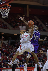12 December 2009: Kashief Edwards reaches for a shot being offered by Lloyd Phillips.  The Purple Eagles of Niagara defeat the Redbirds of Illinois State 76-68 on Doug Collins Court inside Redbird Arena in Normal Illinois.