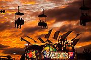 Carnival goers on amusement rides as the sun sets over the Coastal Carolina Fair in Charleston, SC.