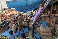 A mischievous girl at City Market, Bangalore, India
