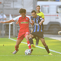 13.09.2020, Carl-Benz-Stadion, Mannheim, GER, DFB-Pokal, 1. Runde, SV Waldhof Mannheim vs. SC Freiburg, <br /> <br /> DFL REGULATIONS PROHIBIT ANY USE OF PHOTOGRAPHS AS IMAGE SEQUENCES AND/OR QUASI-VIDEO.<br /> <br /> im Bild: Woo-yeong Jeong (SC Freiburg #29) gegen Rafael Garcia (SV Waldhof Mannheim #16)<br /> <br /> Foto © nordphoto / Fabisch
