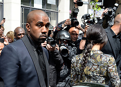 """File photo of Kim Kardashian, Kanye West, their baby baby North and Kris Jenner are spotted leaving their apartment in Paris, France on May 23, 2314. Kim Kardashian West spoke out about Kanye West's bipolar disorder Wednesday, three days after the rapper delivered a lengthy monologue at a campaign event touching on topics from abortion to Harriet Tubman, and after he said he has been trying to divorce her.Kardashian West said in a statement posted in an Instagram Story that she has never spoken publicly about how West's bipolar disorder has affected their family because she is very protective of their children and her husband's """"right to privacy when it comes to his health."""" Photo by ABACAPRESS.COM"""
