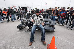 Picking up a bike can be easy as they show in the police skills demonstration area at the Harley-Davidson display at Daytona International Speedway on the first day of Daytona Beach Bike Week 2015. FL, USA. Saturday, March 7, 2015.  Photography ©2015 Michael Lichter.