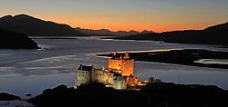 The historic floodlit Eilean Donan Castle with the sun setting behind the Cuillin mountain range on the Isle of Skye.. .. (c) Stephen Lawson | Edinburgh Elite media