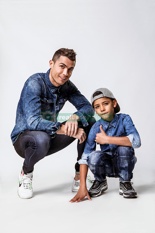 "Cristiano Ronaldo's seven-year-old son is a chip off the old block as they both model matching double denim looks in a campaign for the footballer's denim line. The duo are seen rocking creations from the Spring/Summer 2018 CR7 Limitless and CR7 Junior lines. The 32-year-old Real Madrid player and his son Cristiano Ronaldo Jr, who is understood to have been born via a surrogate mother, pose up a storm in a series of denim looks, and the youngster also steps into the spotlight for some solo shots too. This is not the first time Cristiano Jr has teamed up with his dad to promote the CR7 line. Ronaldo previously explained: ""For me, the CR7 Junior collection is all about having fun and being free, being creative and confident. ""The stretch denim we have used in the collection is extremely comfortable due to the technical elements in the fabric, which will allow boys to run around and be active, move freely and most importantly, play."" Ronaldo is also father to nine-month-old surrogate twins Mateo and Eva Maria and his girlfriend Georgina Rodriguez gave birth to his fourth child, daughter Alana, in November 2017. 10 Mar 2018 Pictured: Cristiano Ronaldo and his son Cristiano Ronaldo Jr pose in clothes from the footballer's CR7 Limitless and CR7 Junior Spring/Summer 2018 lines. Photo credit: CR7/ MEGA TheMegaAgency.com +1 888 505 6342"