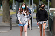Two young girls walk across Princes Bridge during the COVID-19 in Melbourne. With over a week of zero cases in Victoria, Premier Daniel Andrews is expected to make major announcements on Sunday about further easing of restrictions. (Photo by Dave Hewison/Speed Media)
