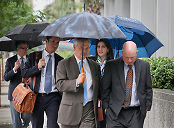 12 June  2015. New Orleans, Louisiana. <br /> Ryan LeBlanc (rt) and Rita Benson LeBlanc (2nd rt) arrive at Civil Distrcit Court on the last day of a hearing to determine the competency of their grandfather Tom Benson. Benson is the billionaire owner of the NFL New Orleans Saints, the NBA New Orleans Pelicans, various auto dealerships, banks, property assets and a slew of business interests. Rita, her brother and mother demanded a competency hearing after Benson changed his succession plans and decided to leave the bulk of his estate to third wife Gayle, sparking a controversial fight over control of the Benson business empire.<br /> Photo©; Charlie Varley/varleypix.com