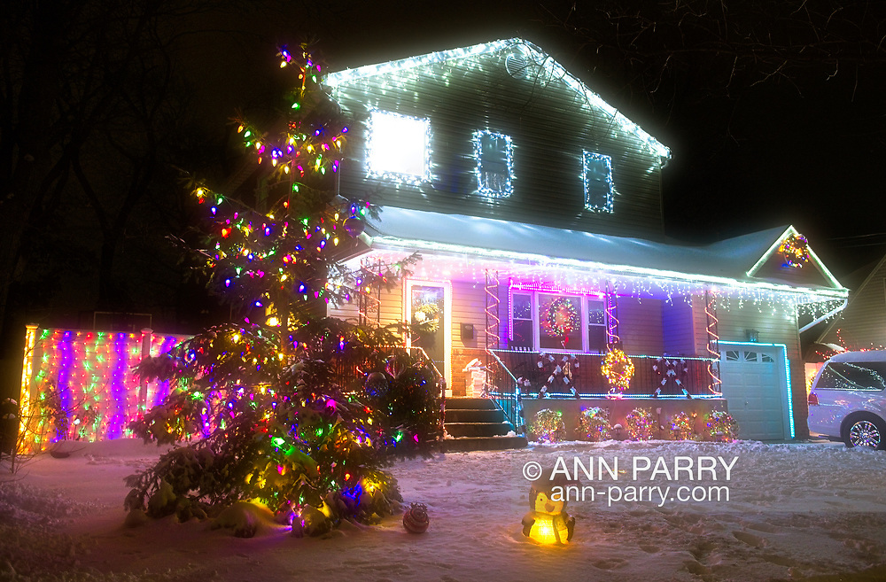 North Merrick, New York, USA.  December 19, 2020. Twenty-nine homes have their front yards decorated, each in a different theme, for the Community Holiday Tree and Lumiere Walk.
