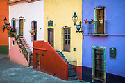 Beautiful staircases at homes in Guanajuato, Mexico<br /> ------<br /> Guanajuato is a city and municipality in central Mexico and the capital of the state of the same name. It is part of the macroregion of Bajío. It is in a narrow valley, which makes its streets narrow and winding. Most are alleys that cars cannot pass through, and some are long sets of stairs up the mountainsides. Many of the city's thoroughfares are partially or fully underground. The historic center has numerous small plazas and colonial-era mansions, churches and civil constructions built using pink or green sandstone.<br /> <br /> The origin and growth of Guanajuato resulted from the discovery of minerals in the mountains surrounding it. The mines were so rich that the city was one of the most influential during the colonial period. One of the mines, La Valenciana, accounted for two-thirds of the world's silver production at the height of its production.<br /> <br /> The city is home to the Mummy Museum, which contains naturally mummified bodies that were found in the municipal cemetery between the mid 19th and 20th centuries. It is also home to the Festival Internacional Cervantino, which invites artists and performers from all over the world as well as Mexico. Guanajuato was the site of the first battle of the Mexican War of Independence between insurgent and royalist troops at the Alhóndiga de Granaditas. The city was named a World Heritage Site in 1988.